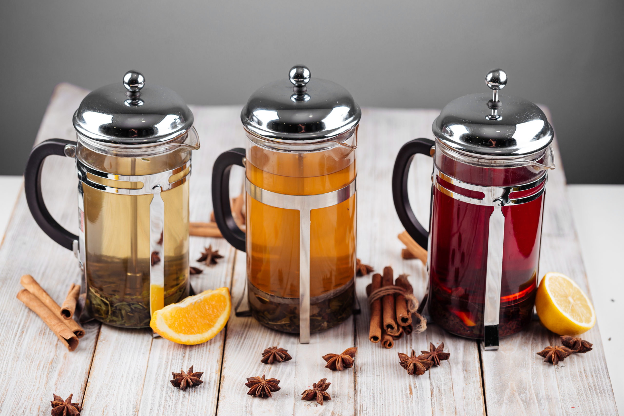 Different fruit teas in french press pots